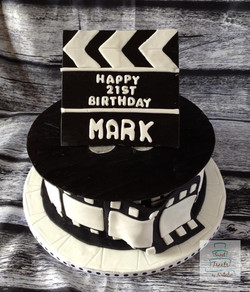 Roll of film/clapper board cake