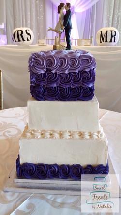 White & Purple Rosette Wedding cake