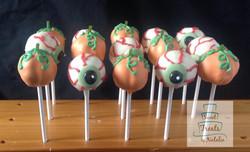 Eyeballs and pumpkins cake pops
