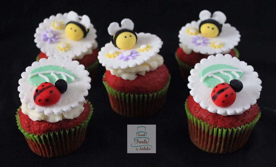 Bees and ladybug topper cupcakes.
