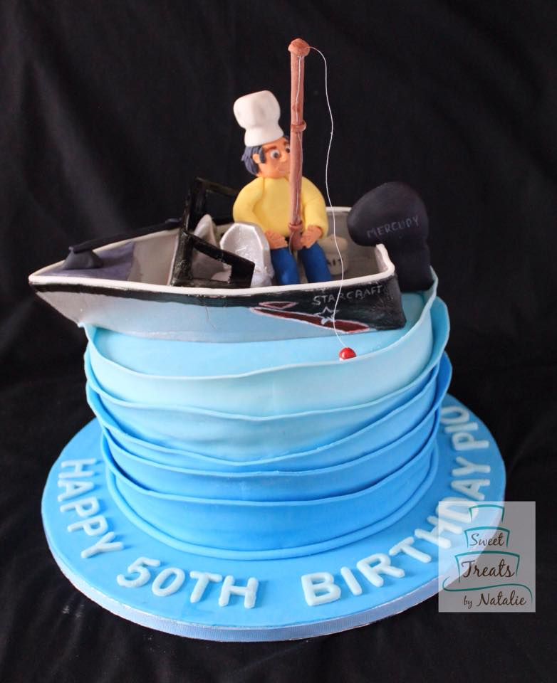 Chef on his fishing boat cake