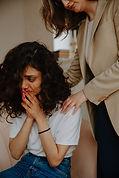 therapist-comforting-patient-3958419.jpg