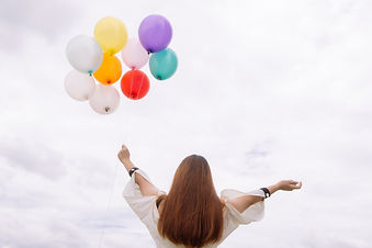 worm-s-eye-view-of-woman-holding-balloon