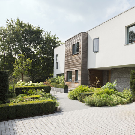 Modern house and garden, formal planting style