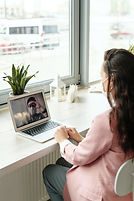 Telemedicine woman-using-her-laptop-on-v