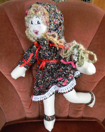 Young Girl, holding lookalike doll