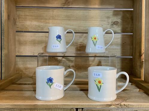 Earthenware embossed mugs and jugs
