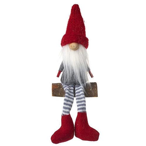 Sitting Fabric Santa on Log
