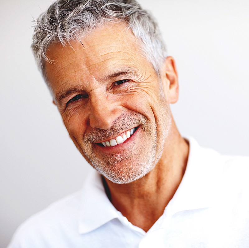 Picture of handsome, older man with gray hair.