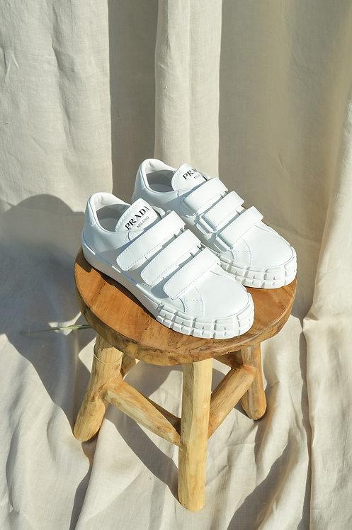 Prada slip on white sneakers