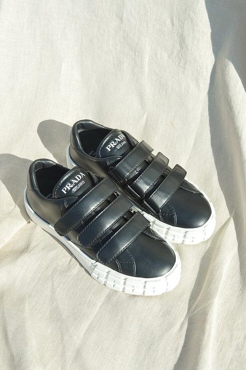 Prada slip on black sneakers