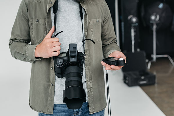 cropped view of professional male photog