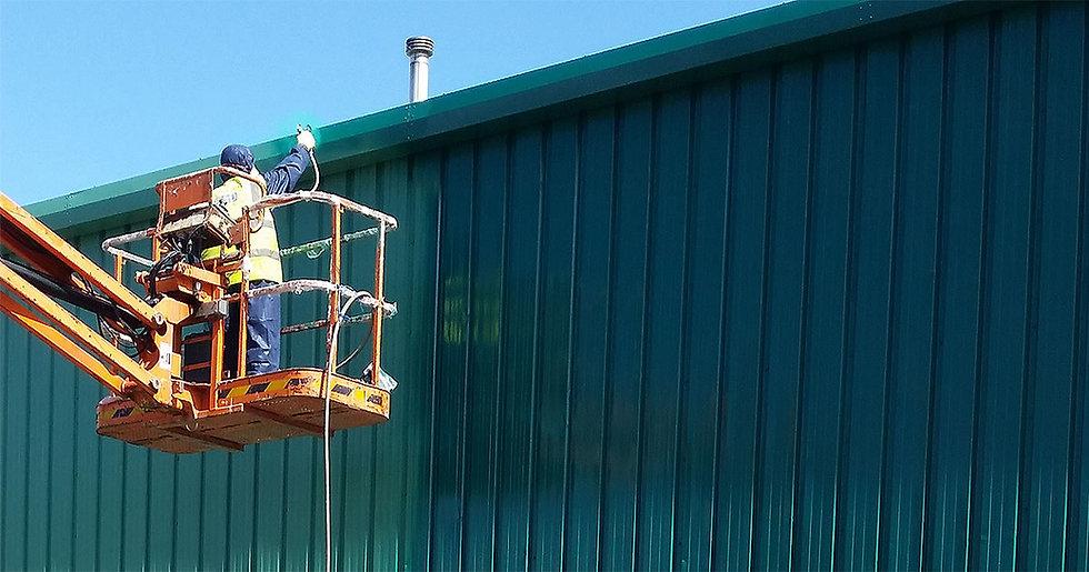 green-cladding-spray-coating-walls-wrexh