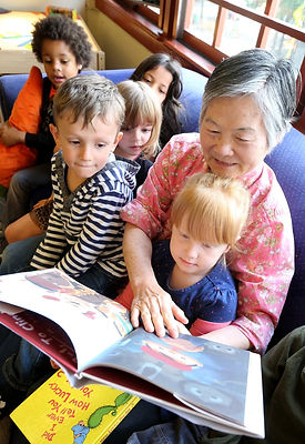 One of PMCCP's Foster Grandparents reading to some of our fantastic kids.