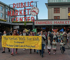 Teachers, kids, and parents walking during our 2017 Walk For Kids outside Pike Place Market.