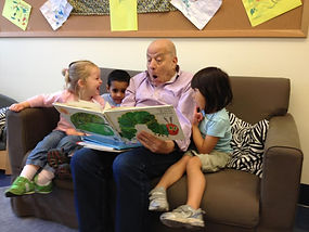 One of our volunteers reading a story to some children at PMCCP.