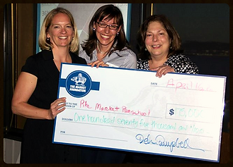 Our Executive Director, Ilene Stark, accepting a check for operations from Lillian Sherman, the Executive Director of the Market Foundation pictured left.