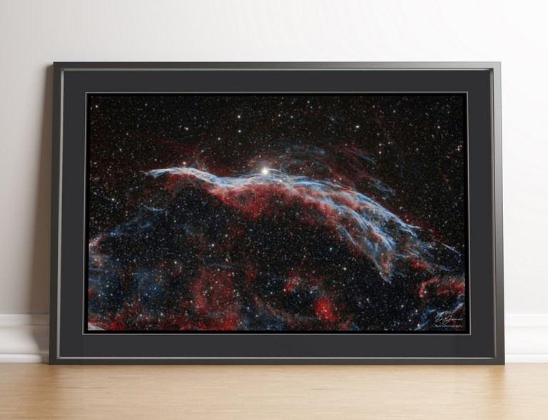 The veil nebula framed print
