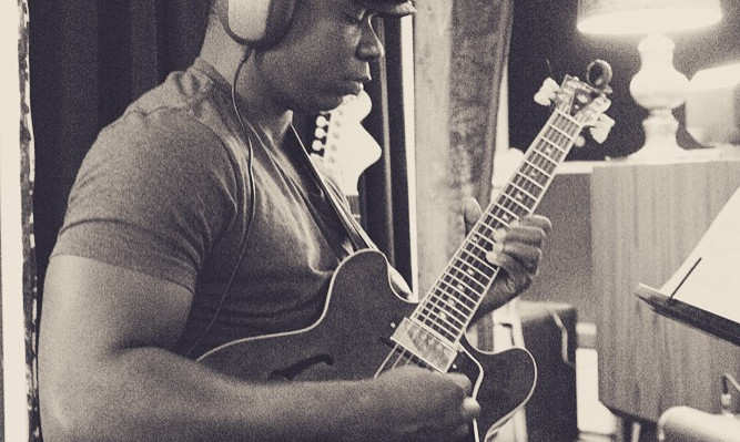 Kipori Woods laying down guitar