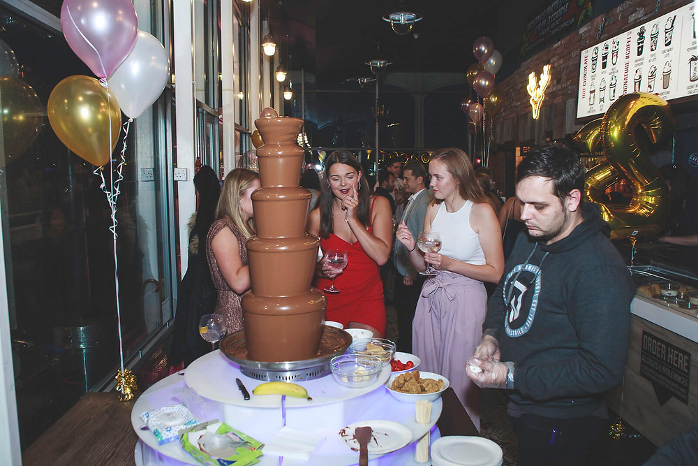 Ellie's 21st Cardiff birthday party photo of chocolate fountain, Coffi Co Lounge Mermaid Quay - Photography by Taz Rahman, South Wales party events photographer