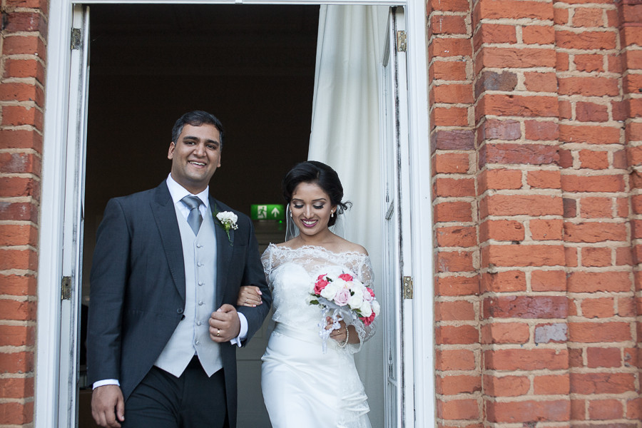 The bride and groom after their wedding at The Grove, Watford, by wedding photographer Taz Rahman