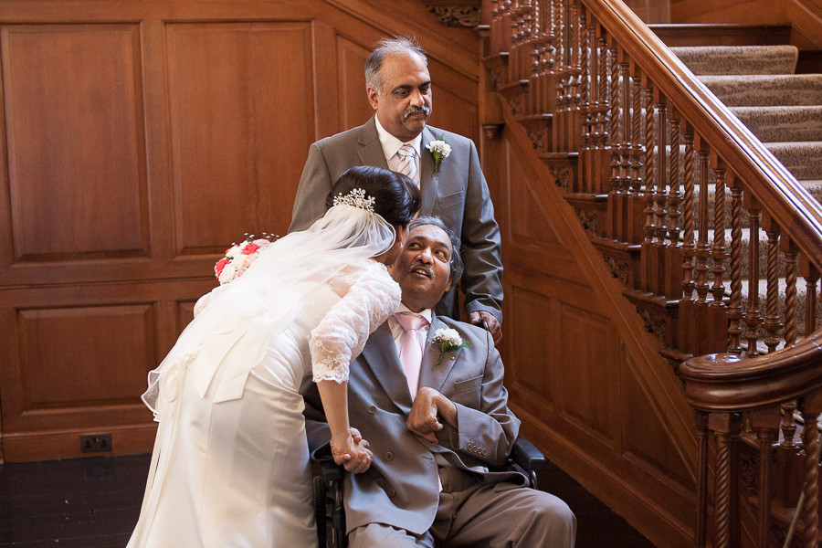 Bride kissing the father, Wedding photography at The Grove, Watford by wedding photographer Taz Rahman