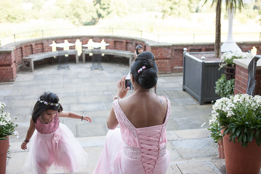 Children playing before ceremony, Wedding photography at The Grove, Watford by wedding photographer Taz Rahman