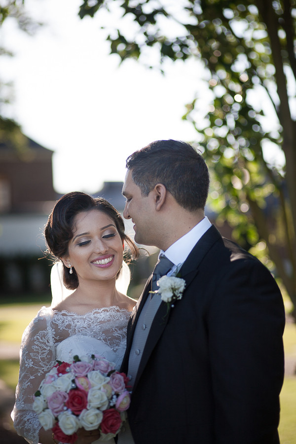 The bride and groom after their wedding at The Grove in Watford, by photographer Taz Rahman
