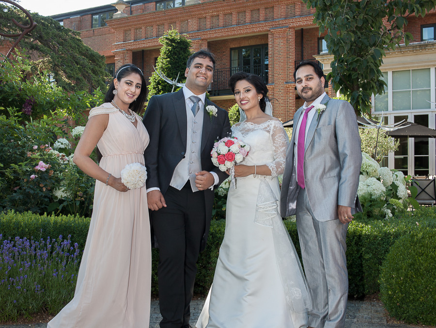 Family group photo after the wedding ceremony at The Grove in Watford, by photographer Taz Rahman