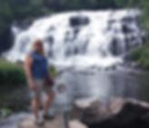 Roxanne standing by Bond Falls