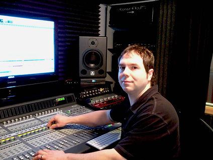 Engineer and producer Jason Ruch at the console in the recording studio at 0x1 Sound Studio / Unable Music Group.