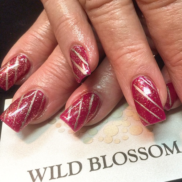 I love candy canes! #candy #nails #nailswag #nailglitter #wildblossom #wildblossomspa #wild #holiday