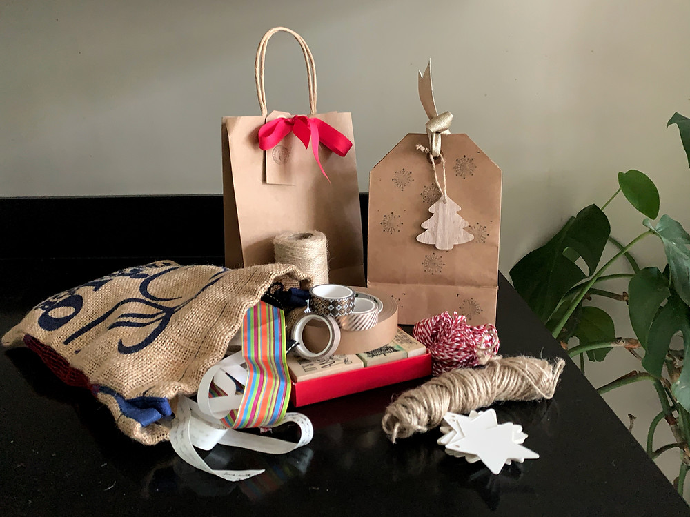 Ecofriendly christmas wrapping supplies to reduce your environmental impact at Christmas and have a more sustainable holiday