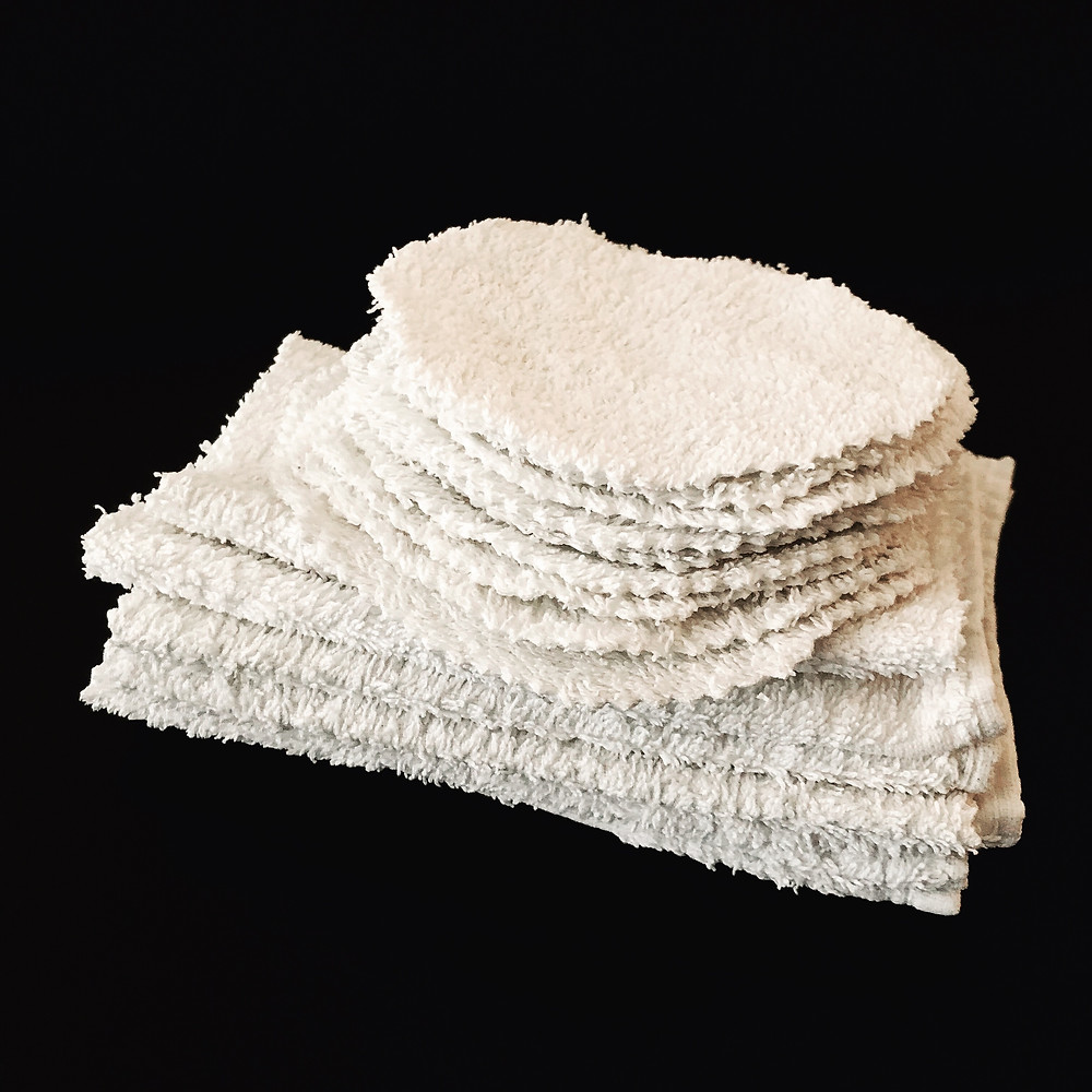Reusable cotton makeup removal pads and facecloths made from a retired bathroom towel