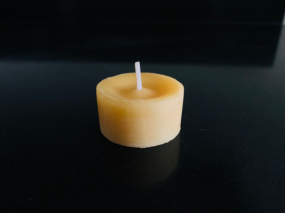 Eco friendly tealight made of beeswax from old honey combs