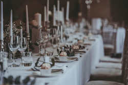 Candle filled banquet table for Winter Wedding