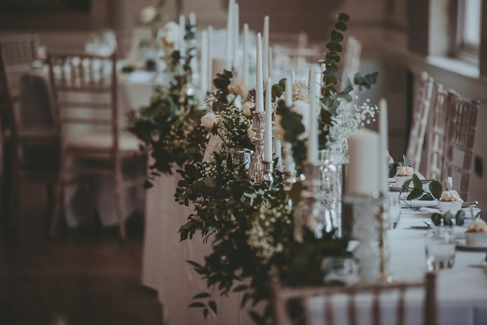 Top table dressed with florals and candles