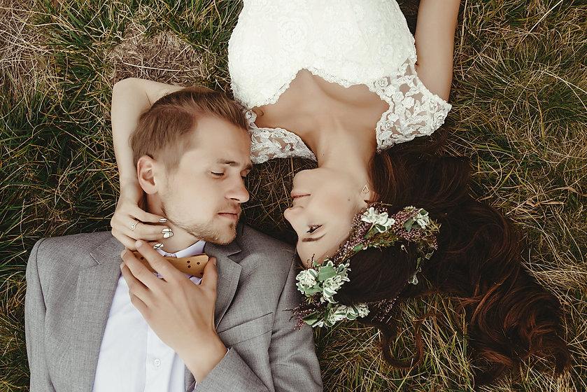 gorgeous bride and stylish groom lying o