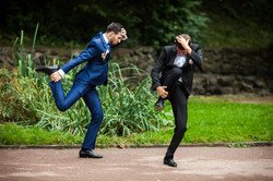 Groom and bestman dancing and goofing