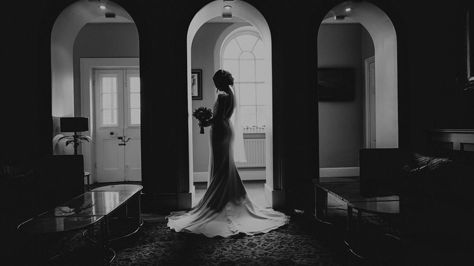 Bride standing in the Arches
