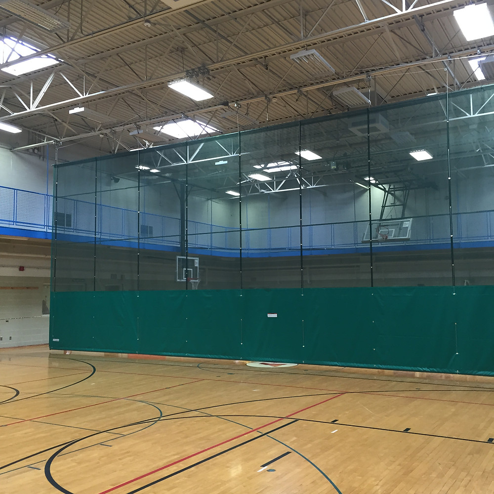 MTJ Sports installs new Fold-Up Curtain at Two Rivers YMCA Gym in Moline, Illinois.  MTJ Sports offers a complete line of Gymnasium Curtains by GARED Sports: Fold-Up Curtains, Roll-Up Curtain, Walk-Draw Curtain, Straight and Radius Systems with Remote Control and PLC options.  MTJ Sports is a full Gymnasium Equipment provider of Basketball and Volleyball Equipment, Curtains, Lighting, Scoreboards with certified installation