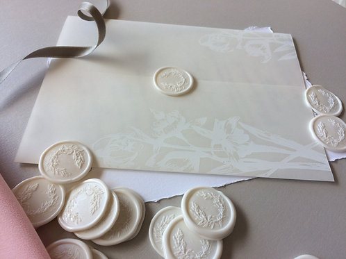 White print on vellum with wax seal