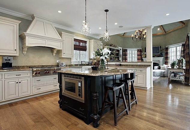 spacious white kitchen with black island