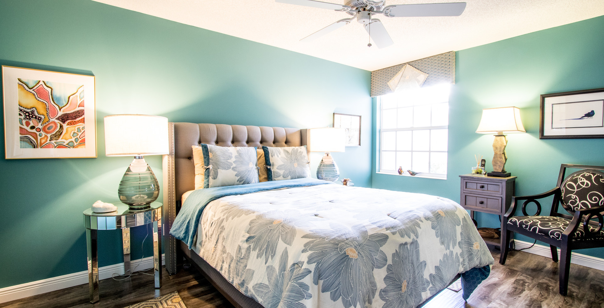 After bright bedroom design with blue/green walls