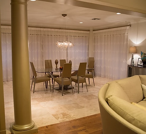 spacious dining room with white curtains