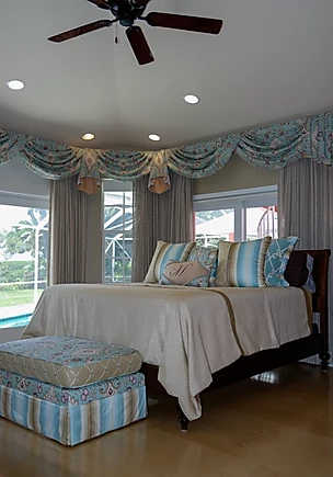 coastal grey bedroom with blue window