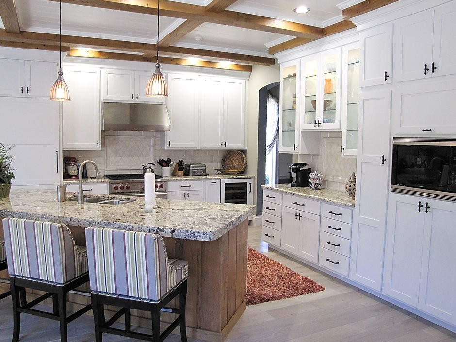 After white coastal kitchen remodel with wood ceiling