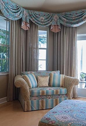 coastal master bedroom with matching window