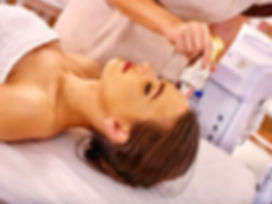 Top view of young woman receiving electroporation  facial therapy at beauty salon. .jpg