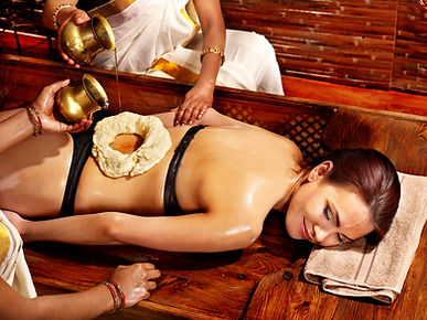 Young woman having stomach Ayurveda spa treatment..jpg